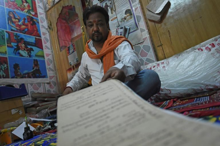 The town's ancient order of some 2,500 Hindu priests have registered births and deaths for visiting pilgrims since time immemorial (AFP Photo/Money SHARMA)