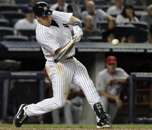 Teixeira's 2 HRs, 5 RBIs lead Yanks over Angels