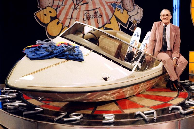 Bullseye: Jim Bowen pictured with one of the game show's extravagant prizes