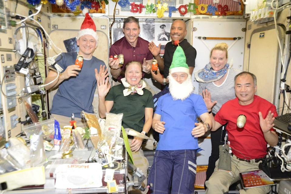 "The astronauts currently living and working on the International Space Station posed for a festive photo to ring in the new year as 2020 became 2021. NASA astronaut Victor Glover shared the photo on Twitter with the caption ""God bless you and this new year! I pray for renewed strength, compassion, and truth and that we can all be surrounded by family and friends..."" Glover flew to the space station as part of SpaceX's Crew-1 mission, the company's first fully operational crewed mission to space."