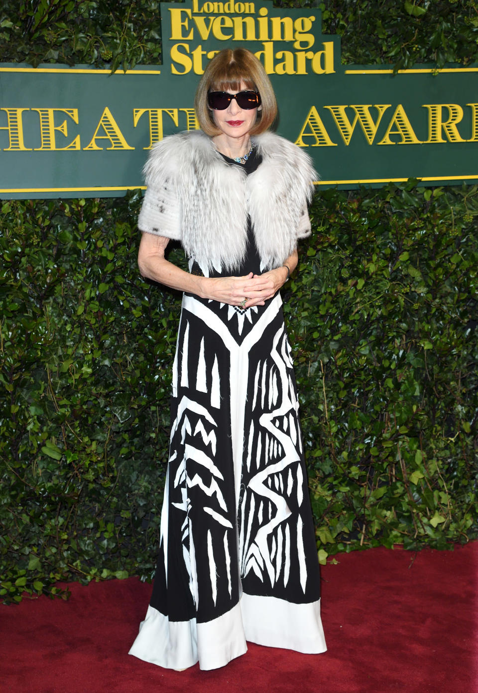 <p>The legendary <i>Vogue</i> editor kept her trademark sunglasses on, pairing them with a monochrome couture gown by Maison Margiela. <i>[Photo: Getty]</i> </p>