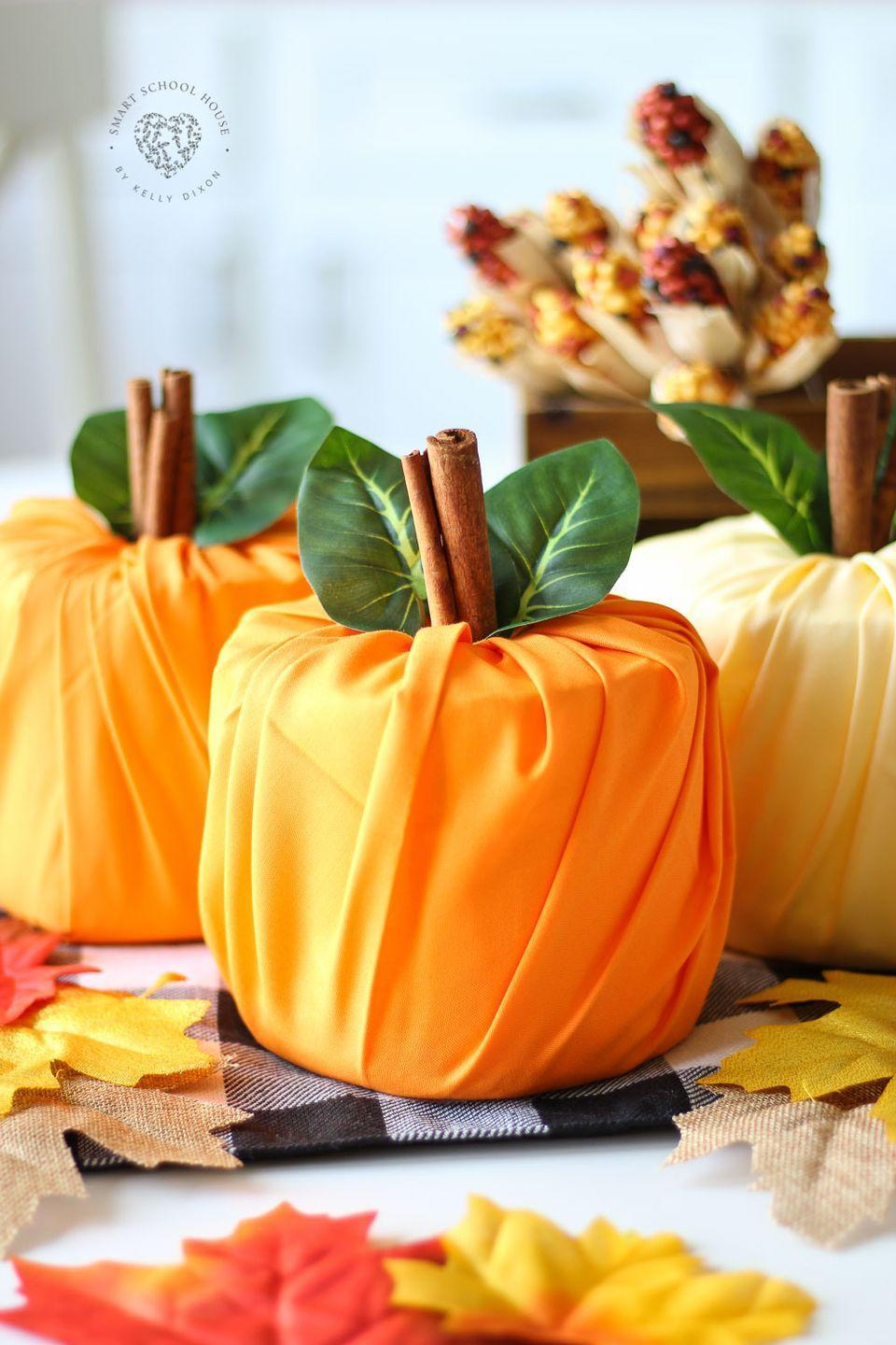 """<p>Who knew toilet paper could look so cute? We love this adorable (and affordable!) fall decorating idea for the bathroom.</p><p><strong>Get the tutorial at <a href=""""https://www.smartschoolhouse.com/diy-crafts/toilet-paper-pumpkins"""" rel=""""nofollow noopener"""" target=""""_blank"""" data-ylk=""""slk:Smart School House"""" class=""""link rapid-noclick-resp"""">Smart School House</a></strong> </p>"""