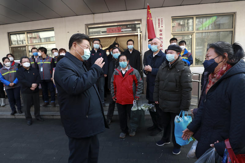 Xi Jinping wearing a protective face mask while speaking to residents in Beijing. Source: AP