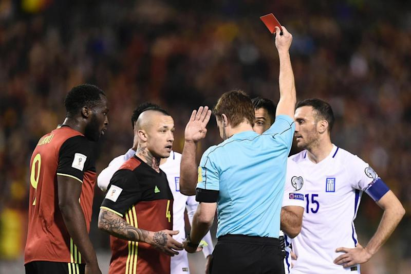 Dismissals | Greece had two men sent off against Belgium (AFP/Getty Images)