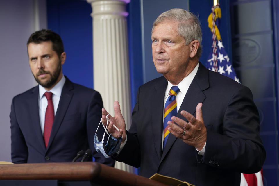 Agriculture Secretary Tom Vilsack, right, speaks during the daily briefing at the White House in Washington, Wednesday, Sept. 8, 2021, as Director of the National Economic Council Brian Deese listens at left. (AP Photo/Susan Walsh)