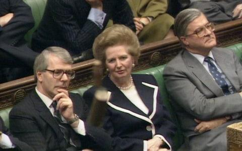 Margaret Thatcher listens to Geoffrey Howe's resignation speech in the Commons in 1990 - Credit: PA