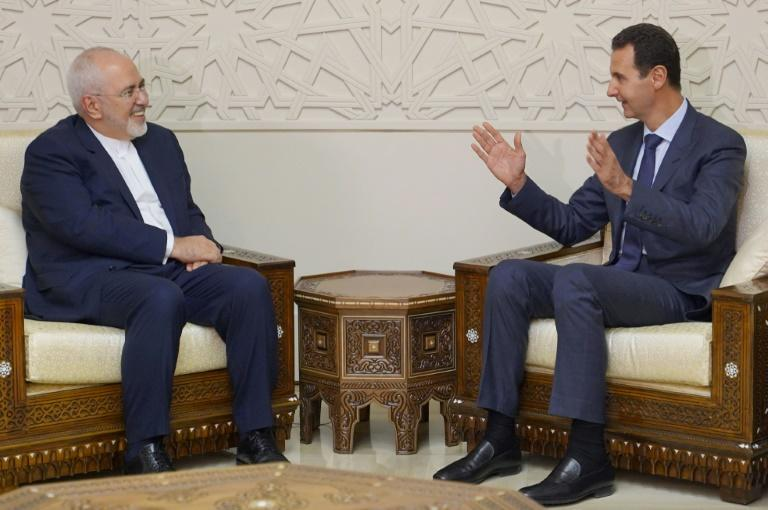 Iranian Foreign Minister Mohammad Javed Zarif's (L) meets with Syrian President Bashar al-Assad