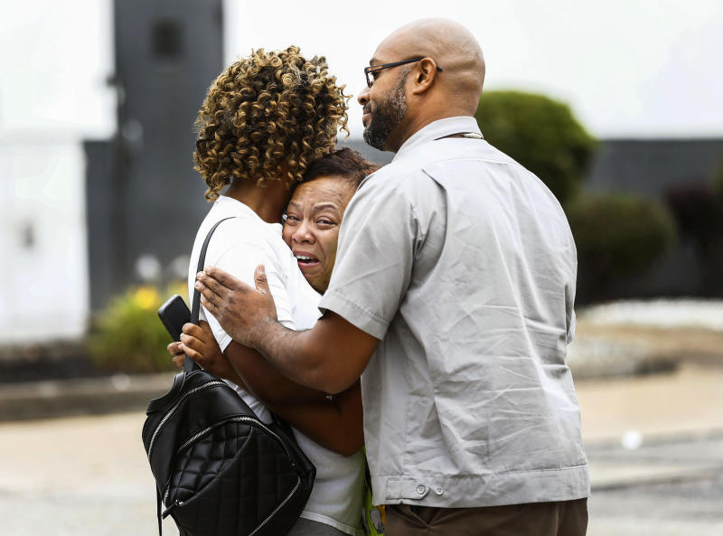 People embrace outside a Walmart store following a shooting Tuesday, July 30, 2019, in Southaven, Miss. A gunman fatally shot two people and wounded a police officer before he was shot and arrested Tuesday at the Walmart in northern Mississippi, authorities said. (Mark Weber/Daily Memphian via AP)
