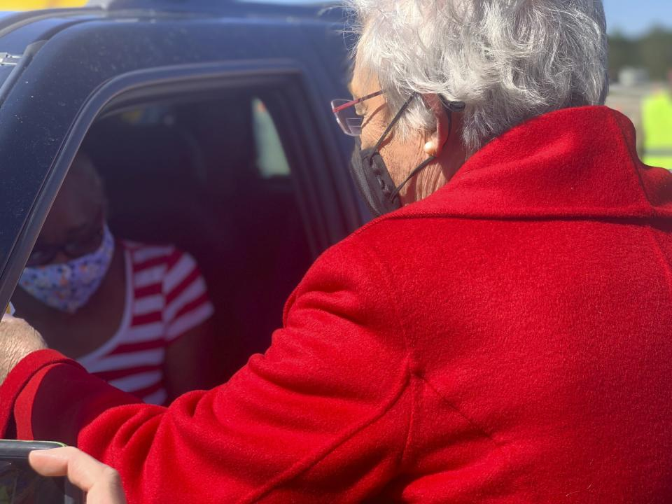 Alabama Gov. Kay Ivey hands a vaccination sticker to Doris Coleston after Coleston received a COVID-19 vaccination at a clinic in Camden, Ala. on Friday, April 2, 2021. (AP Photo/Kim Chandler)