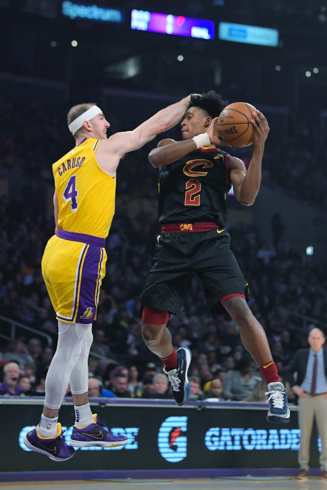 Cleveland Cavaliers guard Kevin Porter Jr., right, shoots as Los Angeles Lakers guard Alex Caruso defends during the first half of an NBA basketball game Monday, Jan. 13, 2020, in Los Angeles. (AP Photo/Mark J. Terrill)