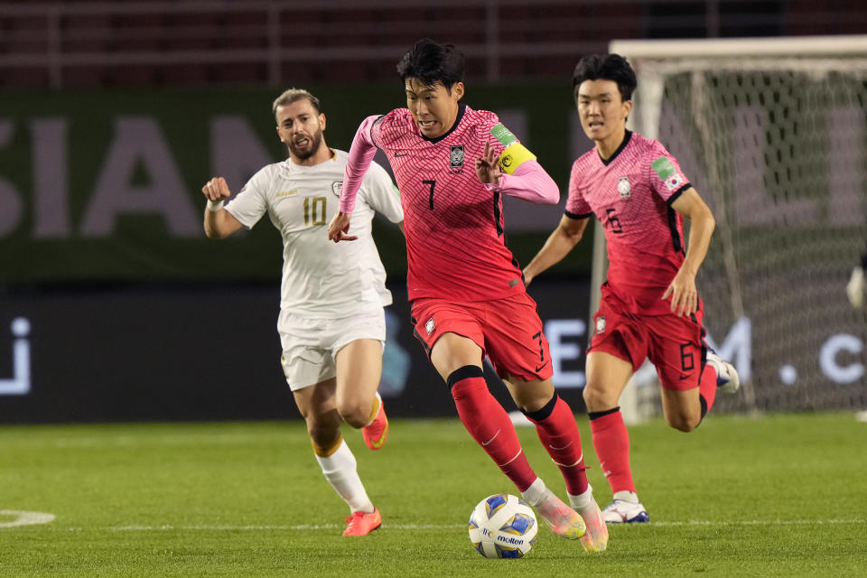 South Korea's Son Heung-min, center, dribbles the ball during the final round of the Asian zone group A qualifying soccer match against Syria for the FIFA World Cup Qatar 2022 at Ansan Wa Stadium in Ansan, South Korea, Thursday, Oct. 7, 2021. (AP Photo/Ahn Young-joon)