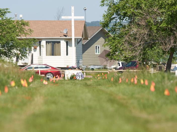 Flags mark the spot where the remains of over 750 children were buried on the site of the former Marieval Indian Residential School in Cowessess first Nation, Saskatchewan, June 25, 2021 (AFP via Getty Images)