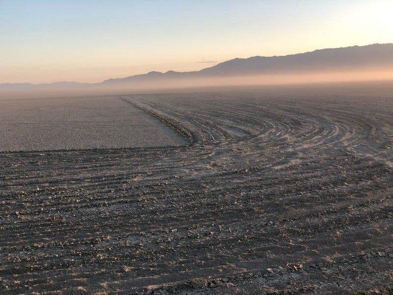 """Tire tracks can be seen in mid-July 2020 on the Black Rock Desert as part of a message that currently is inscribed in the playa crust, reading """"Black Lives Matter."""""""
