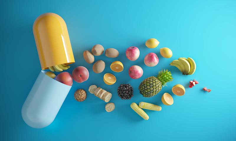An opening capsule and coming through foods, fruits. ( 3d render )