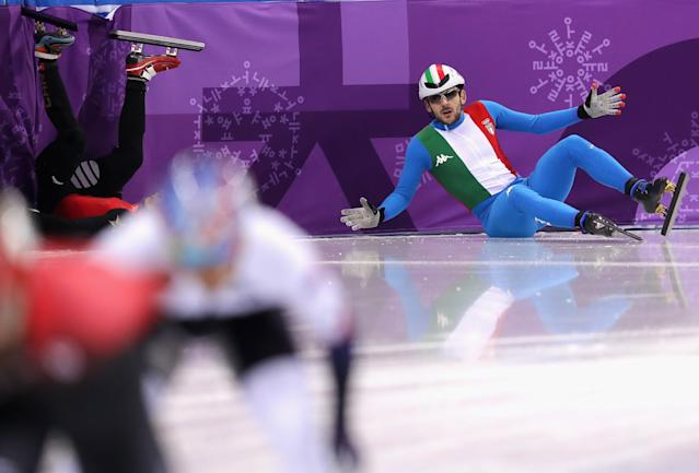 <p>Yuri Confortola of Italy crashes during the Men's 1500m Short Track Speed Skating qualifying on day one of the PyeongChang 2018 Winter Olympic Games at Gangneung Ice Arena on February 10, 2018 in Gangneung, South Korea. (Photo by Richard Heathcote/Getty Images) </p>