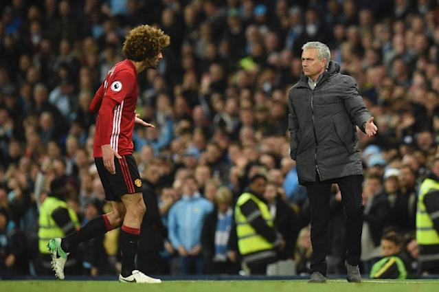 Manchester United's midfielder Marouane Fellaini (L) reacts to Manchester United's manager Jose Mourinho (R) as he leaves the pitch after being sent off during the English Premier April 27, 2017 (AFP Photo/Oli SCARFF )