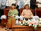 FILE PHOTO: Myanmar's pro-democracy leader Suu Kyi and NLD leader Thin Oo sit in the election commission office as they register the NLD for any upcoming elections in Naypyitaw
