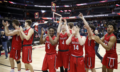 Members of the Davidson team cheer the fans after an NCAA college basketball game against St. Bonaventure in the semifinals of the Atlantic 10 Conference tournament, Saturday, March 10, 2018, in Washington. Davidson won 82-70. (AP Photo/Alex Brandon)