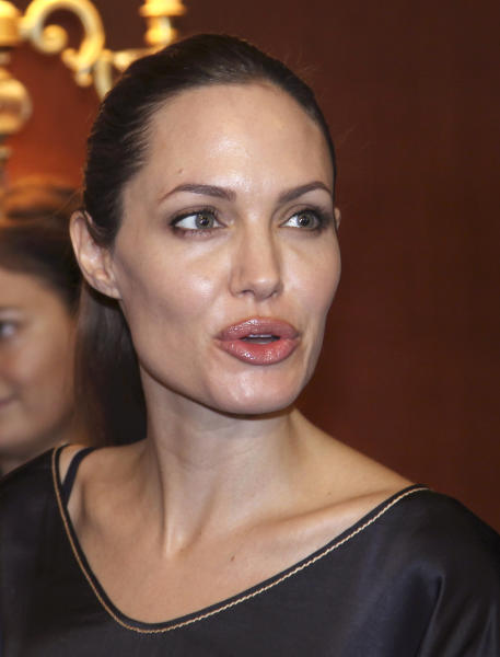 Hollywood star Angelina Jolie, in her role as special envoy for the U. N. refugee agency, speaks during a meeting with Turkey's Interior Minister Idris Naim Sahin, unseen, in Ankara, Turkey, Friday, Sept. 14, 2012. Jolie met with Syrian refugees in Turkey Thursday, where there are more than 80,000 Syrian refugees in 11 camps. (AP Photo/Burhan Ozbilici)