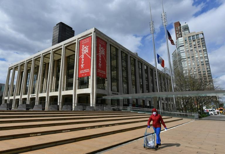 A woman pushes a cart outside Lincoln Center and the New York Philharmonic at the height of the pandemic in the city in April 2020