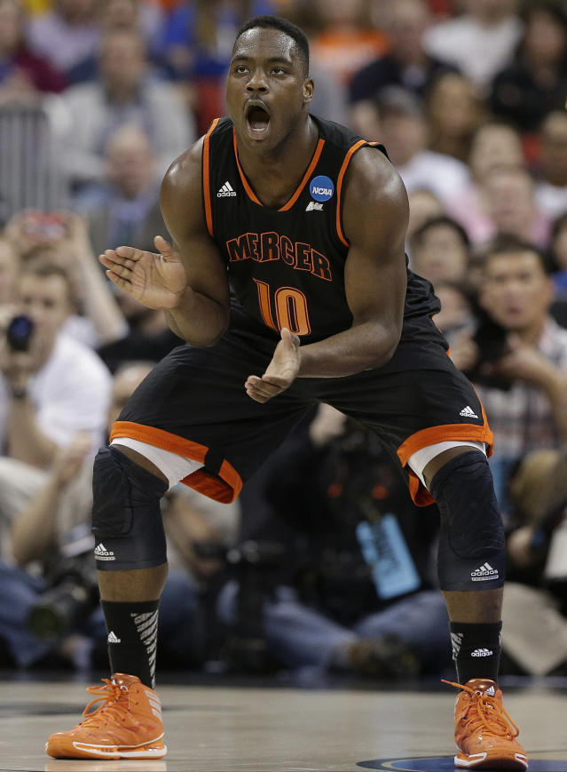 Mercer guard Ike Nwamu (10) celebrates during the first half of an NCAA college basketball second-round game against Duke, Friday, March 21, 2014, in Raleigh, N.C. (AP Photo/Chuck Burton)