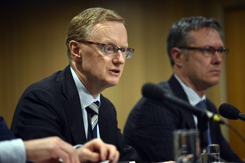 """New Reserve Bank of Australia Governor Philip Lowe (L) speaks at a parliamentary economics committee hearing flanked by new Deputy Governor Guy Debelle (R) in Sydney on September 22, 2016. Lowe said the central bank were not """"nutters"""" about keeping inflation in a tight range, and are instead maintaining a flexible approach as Australia, like other economies, battles low inflation amid subdued oil prices and tepid global trade. / AFP / PETER PARKS (Photo credit should read PETER PARKS/AFP via Getty Images)"""