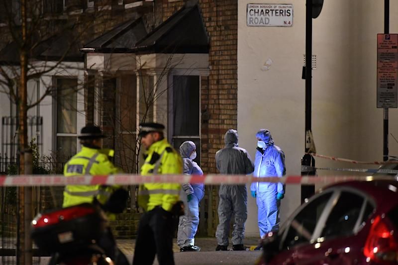 Forensic officers at the crime scene after Metropolitan police cordon off Charteris Road close to the junction with Lennox Road in Finsbury Park after a man was stabbed to death in north London on Friday evening.