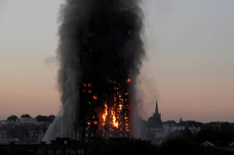 Inquiry into London's deadly Grenfell fire begins asking who was to blame