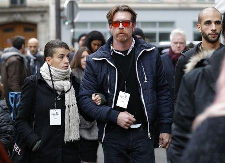 Jesse Hughes (C), member of Eagles of Death Metal band, and relatives arrive at Paris 11th district town hall, France, November 13, 2016, during a ceremony held for the victims of last year's Paris attacks which targeted the Bataclan concert hall as well as a series of bars and killed 130 people.    REUTERS/Philippe Wojazer