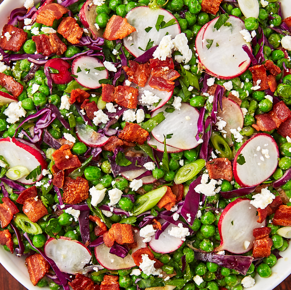 """<p>When you think pea <a href=""""https://www.delish.com/uk/cooking/recipes/g28841001/tomato-salad/"""" rel=""""nofollow noopener"""" target=""""_blank"""" data-ylk=""""slk:salad"""" class=""""link rapid-noclick-resp"""">salad</a> you probably think about the heavy mayo ridden ones. Great in their own ways, but we decided to lighten ours up a bit. This one is fresh, crunchy, and has the most addicting bacon vinaigrette you'll be tempted to pour over everything.</p><p>Get the <a href=""""https://www.delish.com/uk/cooking/recipes/a31987376/pea-salad-recipe/"""" rel=""""nofollow noopener"""" target=""""_blank"""" data-ylk=""""slk:Bacon Pea Salad"""" class=""""link rapid-noclick-resp"""">Bacon Pea Salad</a> recipe.</p>"""