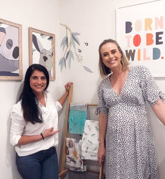 A photo of Sylvia Jeffreys and Anita Birges in her unborn son's nursery room.