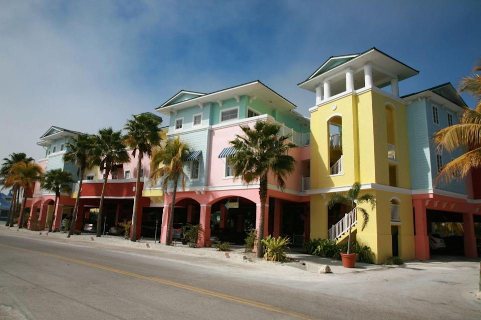 <p>The Floridian sun shines on pale-hued colorful buildings—an appropriate scheme in the Sunshine State.</p>