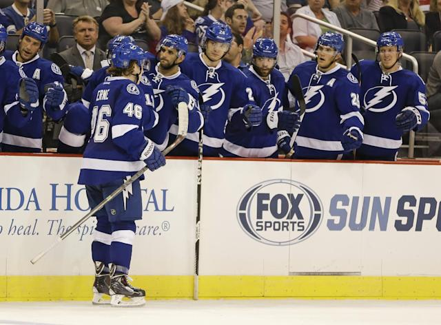 Tampa Bay Lightning left wing Adam Erne (46) gets high fives from teammates after scoring a goal against the St. Louis Blues during the second period of an NHL preseason hockey game in Orlando, Fla., Wednesday, Sept. 18, 2013.(AP Photo/John Raoux)