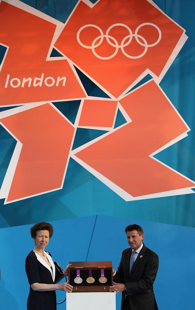 LONDON, ENGLAND - JULY 27: Princess Anne, Princess Royal and LOCOG Chairman Sebastian Coe present the Olympic medals during the' London 2012 - One Year To Go' ceremony in Trafalgar Square on July 27, 2011 in London, England. The one year countdown to the London 2012 Olympic games was marked with a unique ceremony in Trafalgar Square, with IOC President Jacques Rogge inviting the world's athletes to compete in next summer's games. (Photo by Dan Kitwood/Getty Images)