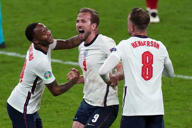 Harry Kane, centre, celebrates after England's 2-1 semi-final victory over Denmark (Mike Egerton/PA).