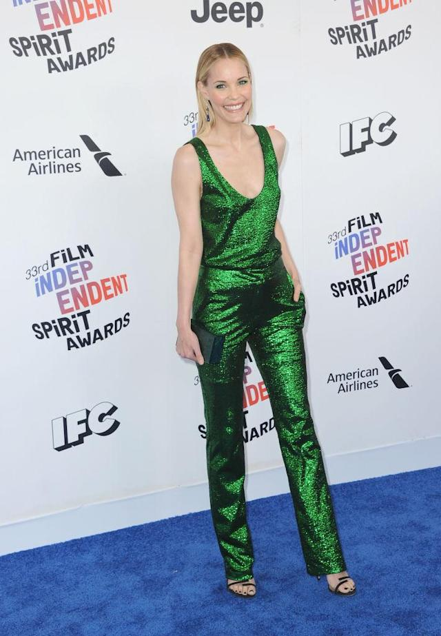 <p>The <em>Iron Man</em> star wore a low-cut green shimmery jumpsuit on the red carpet. (Photo: Getty Images) </p>