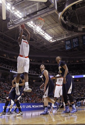 Syracuse forward C.J. Fair (5) ducks the ball as California forward Robert Thurman (34) and California forward Richard Solomon, right, looks on during the first half of a third-round game in the NCAA college basketball tournament Saturday, March 23, 2013, in San Jose, Calif. (AP Photo/Tony Avelar)