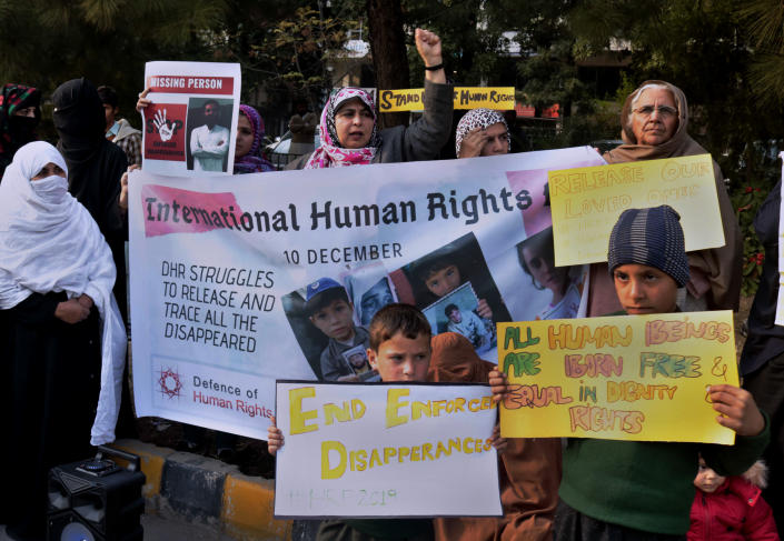 Pakistani families hold pictures of their missing family members during a demonstration to mark World Human Rights Day in Islamabad, Pakistan, Tuesday, Dec. 10, 2019. Dozens of Pakistanis whose relatives were allegedly detained by security agencies in recent years urged prime minister Imran Khan Khan to immediately order the release of their loved ones, as activists observed Human Rights Day across the country. (AP Photo/A.H. Chaudary)