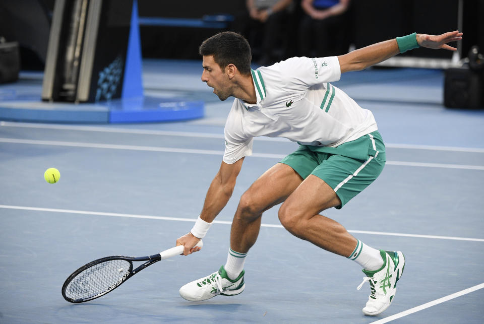Novak Djokovic reaches for a ball.