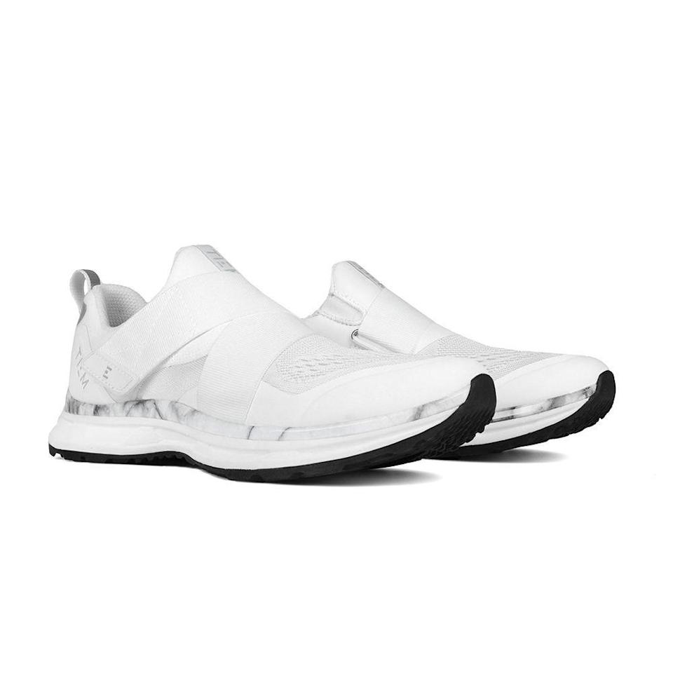 "<p><strong>Tiem Athletic</strong></p><p>tiemathletic.com</p><p><strong>$130.00</strong></p><p><a href=""https://www.tiemathletic.com/collections/cycling/products/slipstream-white-marble"" rel=""nofollow noopener"" target=""_blank"" data-ylk=""slk:Shop Now"" class=""link rapid-noclick-resp"">Shop Now</a></p><p>If you want a Spin shoe that looks identical to your favorite walking shoe, this is it. This slip-on style is ideal for someone who travels to and from cycling classes often and doesn't want to lug around an extra pair of shoes. The downside? They'll transfer less power than stiffer alternatives and are only compatible with SPD cleats.</p>"