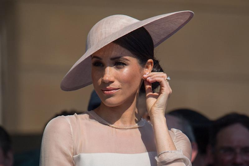 Meghan Markle during a garden party at Buckingham Palace in London, a few days before her coat of arms was unveiled: Dominic Lipinski/PA Wire
