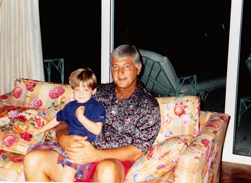Mike Yastrzemski sits with his Hall of Fame grandfather, Carl, as a child.