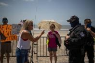 Local residents protest closed beaches on 4th of July amid the global outbreak of the coronavirus disease in Galveston, Texas