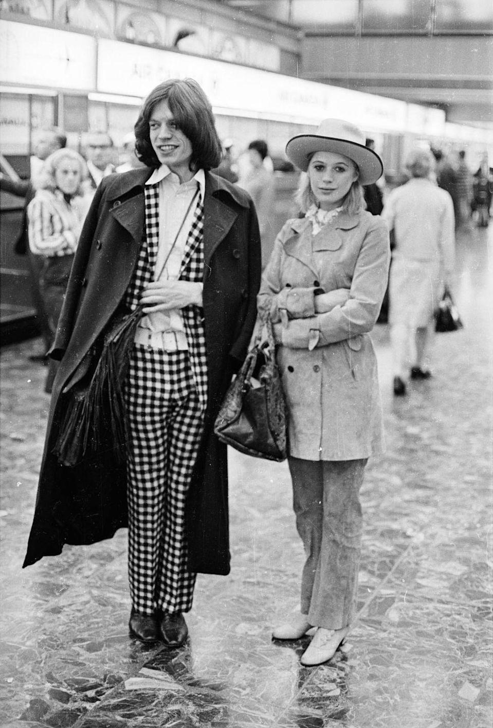 <p>Marianne Faithfull and Mick Jagger at London Airport in 1969.</p>