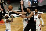 Milwaukee Bucks' Giannis Antetokounmpo shoots past LA Clippers' Paul George, Marcus Morris Sr. and Ivica Zubac during the second half of an NBA basketball game Sunday, Feb. 28, 2021, in Milwaukee. (AP Photo/Morry Gash)