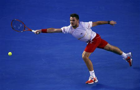 Stanislas Wawrinka of Switzerland hits a return to Tomas Berdych of the Czech Republic during their men's singles semi-final match at the Australian Open 2014 tennis tournament in Melbourne January 23, 2014. REUTERS/David Gray