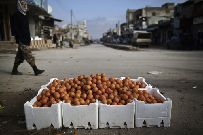 In this Thursday, Dec. 13, 2012, photo, oranges are displayed for sale by a Syrian vendor, not pictured, at a roadside in Maaret Misreen, near Idlib, Syria. The town is broke, relying on a slowing trickle of local donations. The rebels, a motley crew of laborers, mechanics and shopowners, have little experience in government. President Bashar Assad's troops still control the city of Idlib a few miles away, making area roads unsafe and keeping Maaret Misreen cut off from most of Syria. (AP Photo/Muhammed Muheisen)