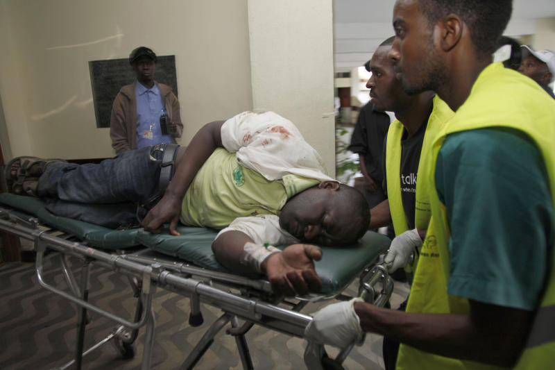 A person injured in a blast on a bus is brought to a hospital in Nairobi, Kenya, Sunday, Nov. 18, 2012. A Kenya police official says that an explosion on a bus in Kenya's capital has killed and injured a number of people. (AP Photo/Sayyid Azim)
