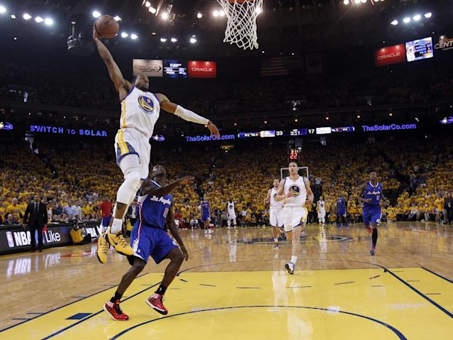 Golden State Warriors' Andre Iguodala (9) dunks past Los Angeles Clippers' Darren Collison (2) during the first half in Game 4 of an opening-round NBA basketball playoff series on Sunday, April 27, 2014, in Oakland, Calif. (AP Photo/Marcio Jose Sanchez)