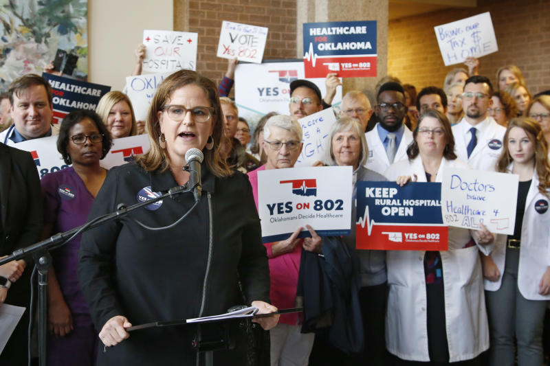 Amber England, who headed the campaign to put Medicaid expansion on the ballot in Oklahoma, speaks before supporters of Yes on 802 Oklahomans Decide Healthcare deliver petitions to the Oklahoma Secretary of State's office, Thursday, Oct. 24, 2019, in Oklahoma City. (AP Photo/Sue Ogrocki)